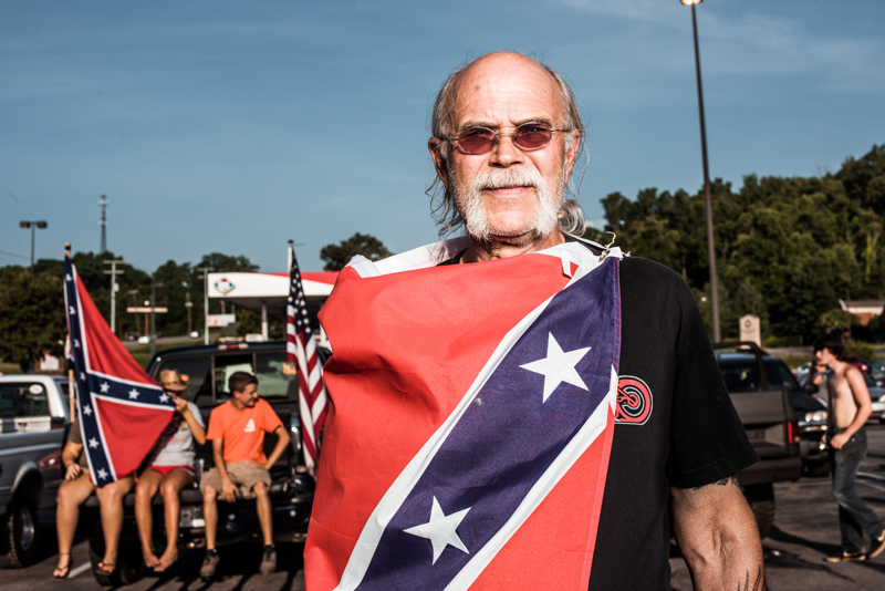 Carl Loveday poses for a portrait during a confederate flag rally held in a parking lot in Seymour, Tennessee on Thursday, July 17, 2015. Host Tom Pierce, and guest, Mathew Heimbach delivered speeches before prompting the group to drive with flags raised through Knoxville. Mike Belleme for Al Jazeera America